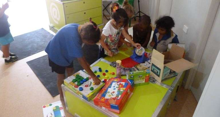 Picture of children of the Mapoon aboriginal community playing with an Ideas box