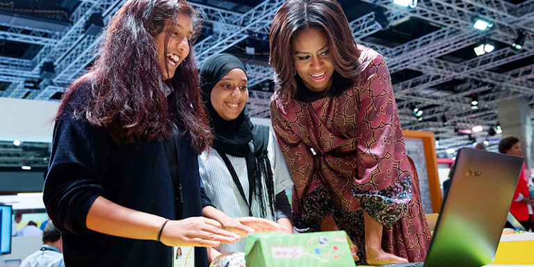 Picture of Michelle Obama and two young women in front of the Ideas Box
